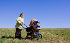 The Girl With A Children S Carriage Stock Image