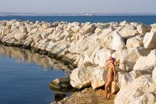 Free Girl Is On Coast Of The Blue Sea Royalty Free Stock Image - 9461606