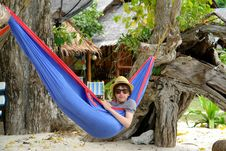 Free Boy In A Hat And Sunglasses In A Blue Hammock Royalty Free Stock Image - 9461796