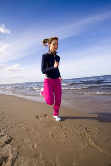 Free Active Woman On The Beach Royalty Free Stock Photography - 9467037