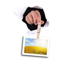 Free Woman Hands Holding Clip Thru Wall Hole Stock Photography - 9467442