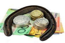Horse Shoe And Money Stock Image