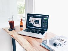 Free Desk With Laptop And Drink Placed On It Royalty Free Stock Image - 94642406