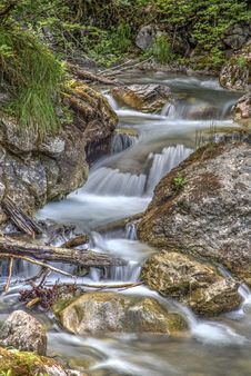Free Clear Running Water In The Middle Of Brown Stones Stock Image - 94642431