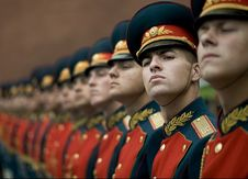 Free Men In Black And Red Cade Hats And Military Uniform Stock Image - 94642471