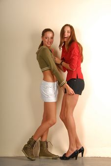 Free Two Pretty Girls In Sport And Classic Styles Royalty Free Stock Photography - 9471177