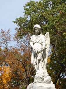 Free Sculpture Of Angel With Trees Stock Images - 9479444