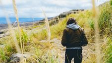 Free Man In Tall Grasses Along Coastline Royalty Free Stock Image - 94778106