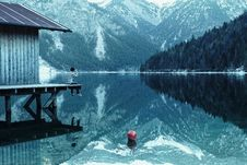 Free Man On Boathouse On Mountain Lake Stock Images - 94789584