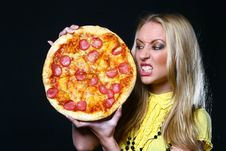 Free Beautiful Young Woman Eating Pizza Stock Image - 9482321