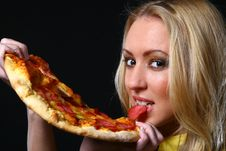 Free Beautiful Young Woman Eating Pizza Royalty Free Stock Photos - 9482468