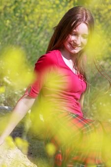 Girl In Yellow Flowers Stock Image