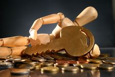 Free Wooden Man, Key And Money. Stock Photography - 9487592