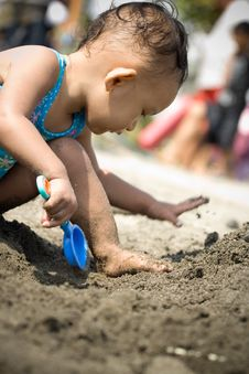 Baby Playing At The Beach Royalty Free Stock Image