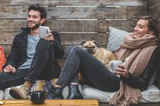 Free Man And Woman With Pug Enjoying Hot Drinks Stock Images - 94886904