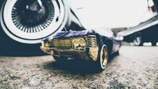 Free Toy Car Next To Real Ones Royalty Free Stock Photos - 94887368