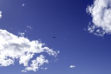 Airplane In The Blue Sky. Royalty Free Stock Photo