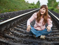 Free The Young Beautiful  Girl Sits On Railway Stock Photography - 9494432