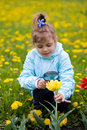 Free Girl Is Looking Through A Magnifying Glass Flower Stock Photos - 9495273