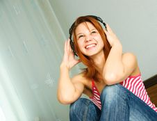 Free Girl Listening Ot The Music Stock Photography - 9492952