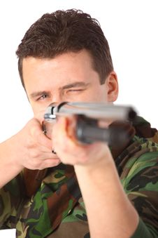 Man In Camouflage  Pointed From Gun Royalty Free Stock Photo