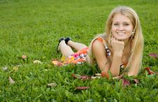 Free Young Woman Lying On A Green Grass Stock Photo - 9495170