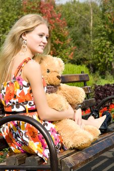 Free Attractive Woman With Teddy Bear In Summer Park Royalty Free Stock Images - 9495189