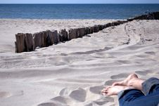 Free Man  S Feet On A Sunny Beach Stock Image - 9496521