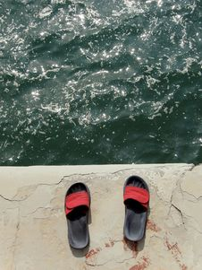 Free Slip-on Shoes And Sea Stock Photo - 9496950