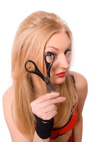 Free Pretty Blonde Looking Though Scissors Isolated Royalty Free Stock Photography - 9497327