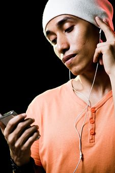 Free Asian Male Listening To Music Royalty Free Stock Photography - 9498887