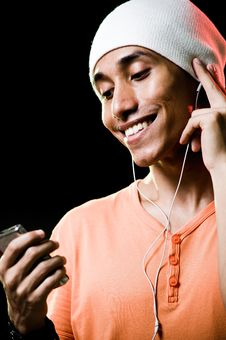 Free Asian Male Listening To Music Royalty Free Stock Photography - 9498897