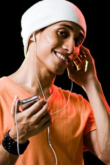 Free Asian Male Listening To Music Stock Image - 9498941
