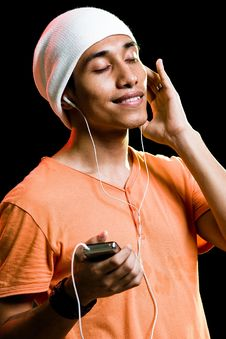 Free Asian Male Listening To Music Stock Photography - 9499272