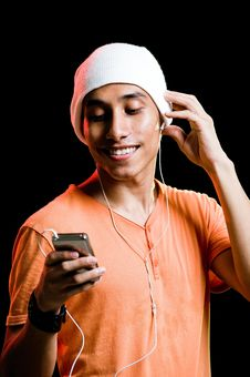 Free Asian Male Listening To Music Royalty Free Stock Photo - 9499285