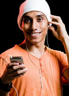 Free Asian Male Listening To Music Royalty Free Stock Images - 9499309