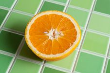 Free Half Of The Juicy Orange On Green Tiled Bar Royalty Free Stock Photo - 9499775