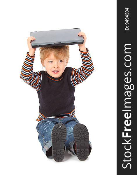 Boy hold laptop on head