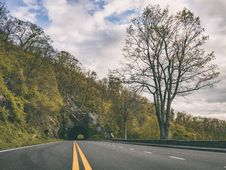 Free Road Through Tunnel In Countryside Royalty Free Stock Images - 94983659