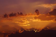 Free Sunset Behind Clouds Stock Photos - 94983693