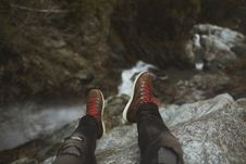 Free Person Sitting On Cliff Wearing Brown Sneakers With Red Lace Royalty Free Stock Photos - 94983718