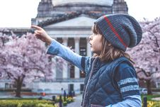 Free Child Looking At Cherry Blossoms Stock Photos - 94983773