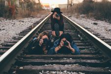 Free Group Of Woman Taking Photo On Train Rails Royalty Free Stock Photo - 94983925