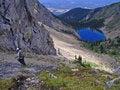 Free Hiker Heading Down To Lake Royalty Free Stock Image - 957706
