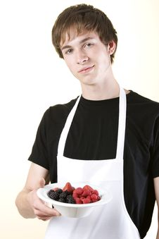 Free Young Man Holding A Bowl Of Fruit Royalty Free Stock Photos - 9502458