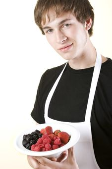 Young Man Holding Bowl Of Berries Royalty Free Stock Images