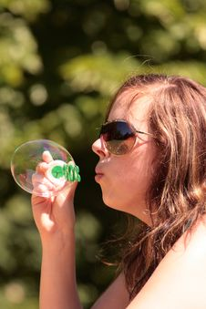 Free Girl Blows A Bubble Stock Photography - 9502472