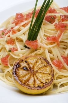 Plate Of Linguine Topped With Diced Tomatos Stock Images
