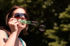 Free Girl Blows Bubbles Stock Photo - 9502620