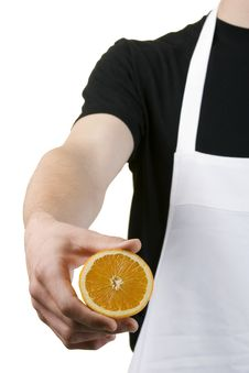 Free Body Of Cook Holding A Freshly Cut Orange Stock Photography - 9502662